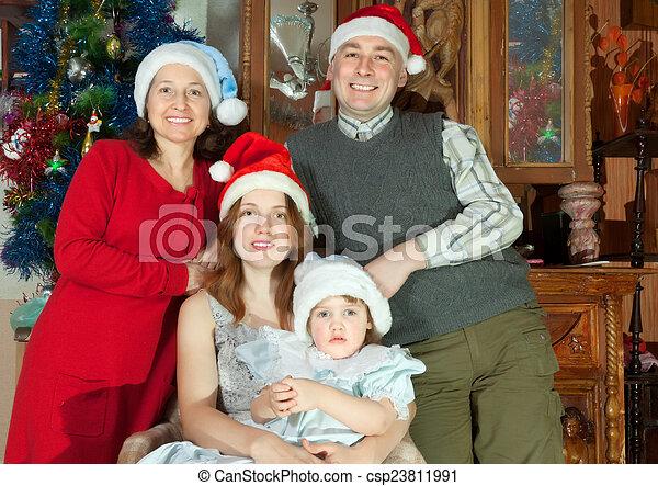 chapeaux, famille heureuse, santa - csp23811991