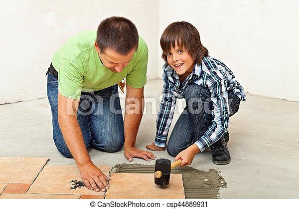 garçon, sien, plancher, placer, père, portion, carreau ceramique - csp44889931